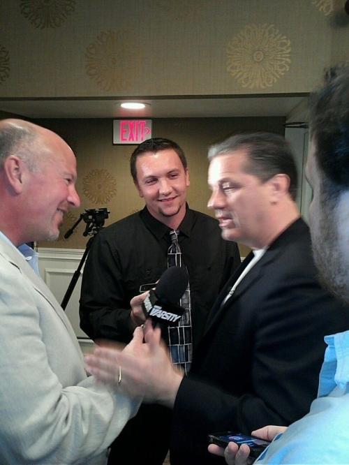Jordan Griffith (center) interviewing national champion University of Kentucky head coach John Calipari last year