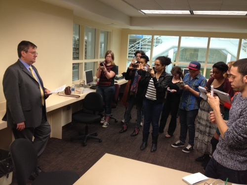 SUNY Purchase Journalism Professor, Ross Daly, faking it for a smartphone presser